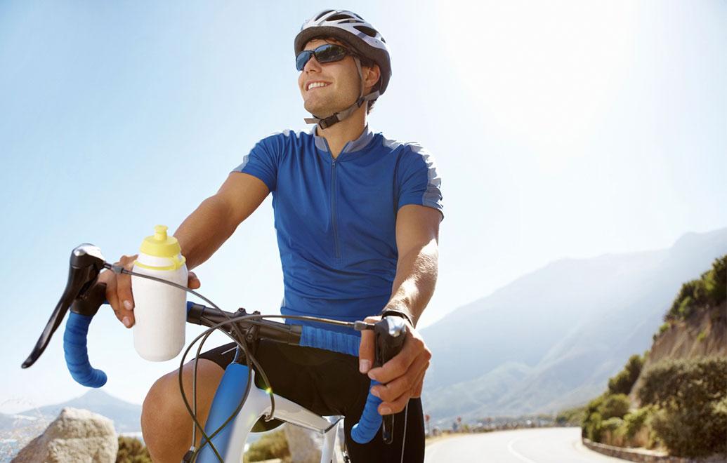 Man on a bike smiling
